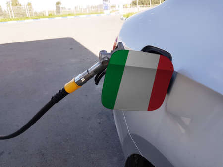 Flag of Italy on the car's fuel tank filler flap. Petrol station. Fueling car at a gas station.