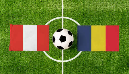 Top view ball with Peru vs. Chad flags match on green football field.