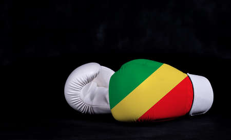 Boxing glove with Congo republic flag on black background