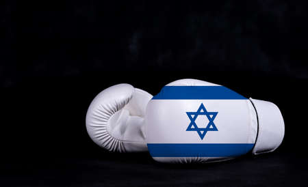Boxing glove with Israel flag on black background