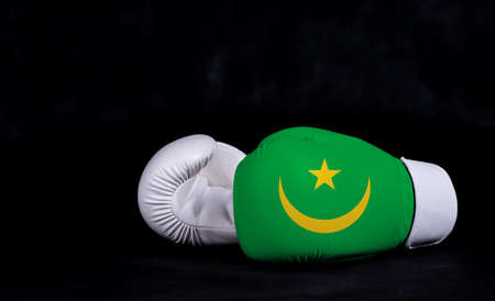 Boxing glove with Mauritania flag on black background