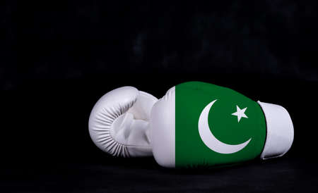 Boxing glove with Pakistan flag on black background