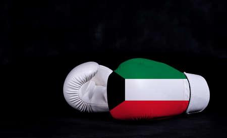 Boxing glove with Kuwait flag on black background