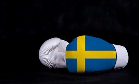 Boxing glove with Sweden flag on black background