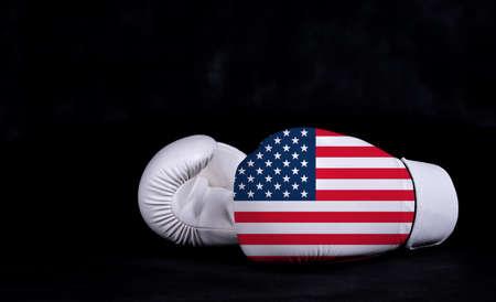 Boxing glove with USA flag on black background Фото со стока