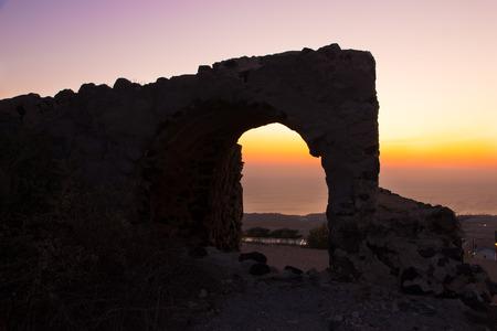 Ruins at sunrise in Fira, Santorini 스톡 콘텐츠