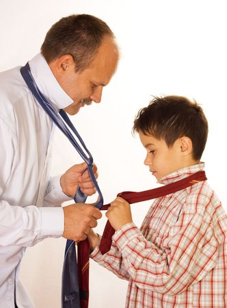Help concept : father shows his son the tie binding