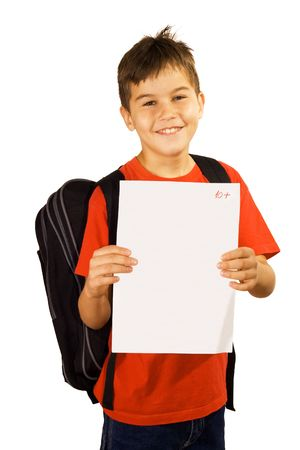 grades: Young boy showing his good qualifications Stock Photo