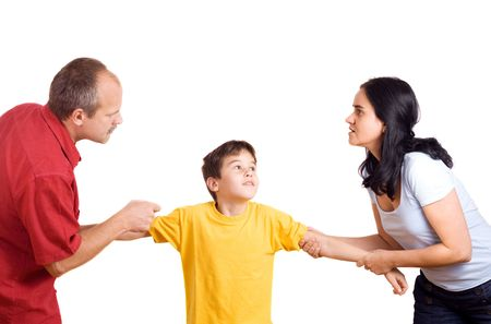 Hands of parents fighting over their son each pulling him their way. photo