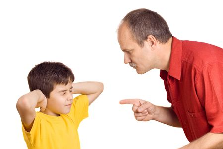 scolding: Father scolding his son with pointed finger