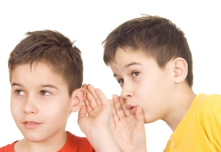 whispering: Boy whispers into the ear of another