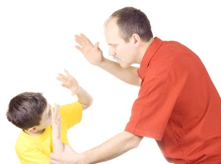 scolding: Young kid about to be thumped by father Stock Photo