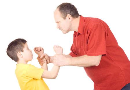 violencia intrafamiliar: J�venes cabrito a punto de ser golpe� por padre Foto de archivo