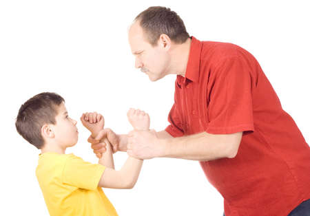 punishment: Young kid about to be thumped by father Stock Photo