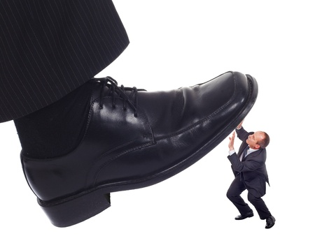 mean: Businessmans foot stepping on tiny businessman-unequal competition concept Stock Photo