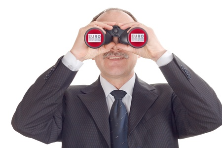 Optimistic businessman looking through binoculars-isolated on white photo