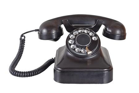 Oude vintage telefoon op wit Stockfoto