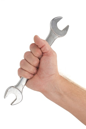 Human hand holding a new wrench, isolated on white photo