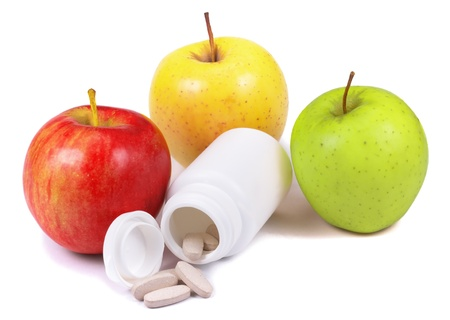 thinness: Three apples, medical bottle and pills over on white background