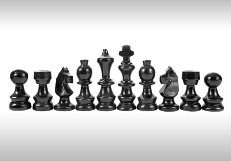 A set of black chess pieces isolated on a white background photo