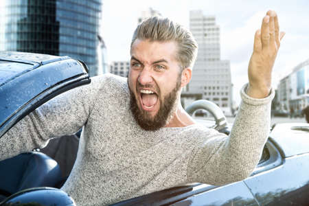 angry man driving a car