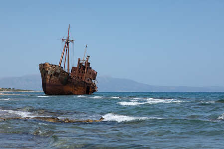 The famous rusty shipwreck near Gytheio at sunset