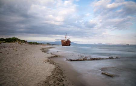 Old rusty ship wreck on a beautiful beach