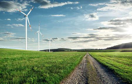 Wind turbines on a beautiful field Stock fotó