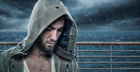 Portrait of a sad man with a beard and a hood Stockfoto