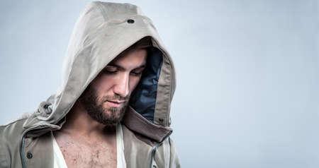 Portrait of a sad man with a beard and a hood Stock fotó