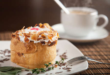 Delicious puff pastry and a fresh coffee with steam