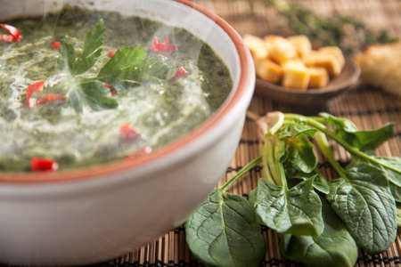 Spinach soup with cream and bread
