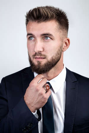 Attractive business man is thoughtful