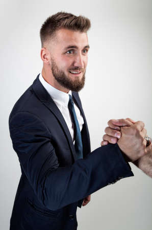 Attractive business man is making a modern hand shake