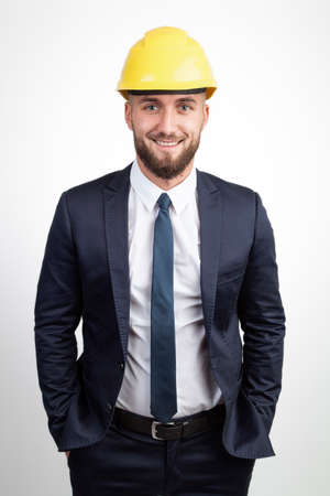 Attractive business man with a yellow helmet