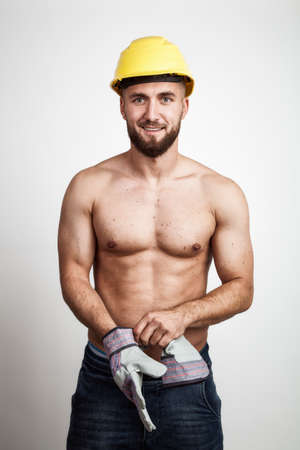 Attractive worker with a yellow helmet