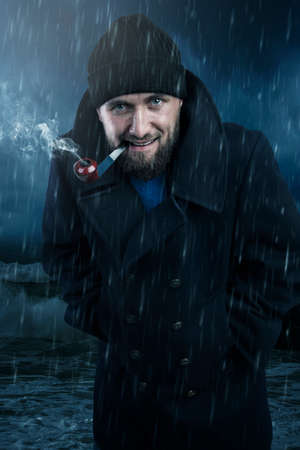 Attractive seaman with aa pipe in the rain