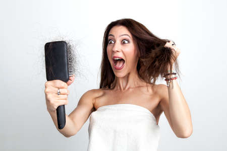 Beautiful woman is screaming because she recognized her hair loss