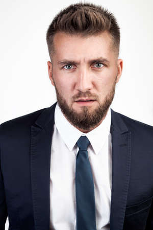 Attractive business man is looking shocked in the camera