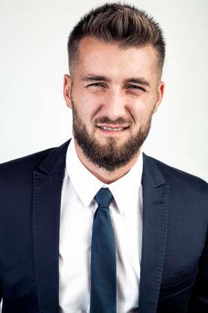 Attractive business man makes a grimace Stock fotó