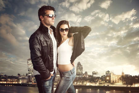 Attractive couple with sunglasses and leather jackets Stockfoto