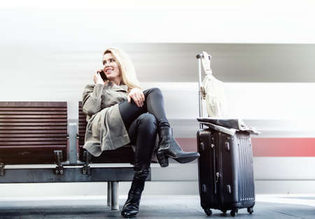 Beautiful blond woman is waiting for the train Stock fotó