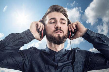 Attractive bearded man with earphones Stock fotó
