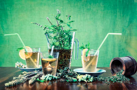 Homemade ice tea with lemon on a green background