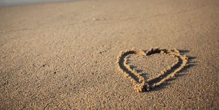 Heart drawn on the sand of a beach