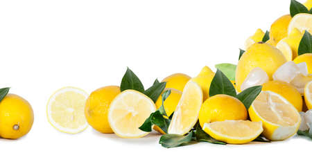 Many lemons in front of a white background