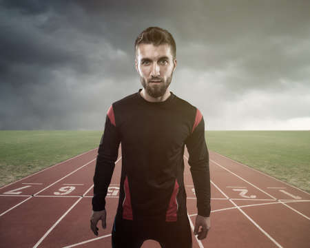 Portrait of an attractive athlete on a track