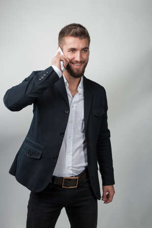 Attractive man with a beard and a smart phone