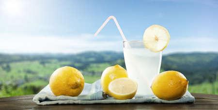 Fresh self-made lemon drink in a beautiful landscape