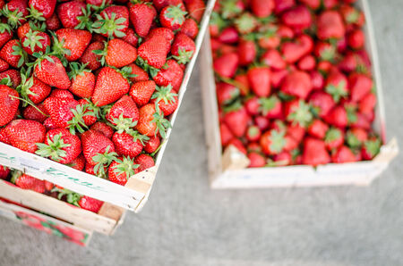 Home grown strawberries in a wooden basket (crate). photo